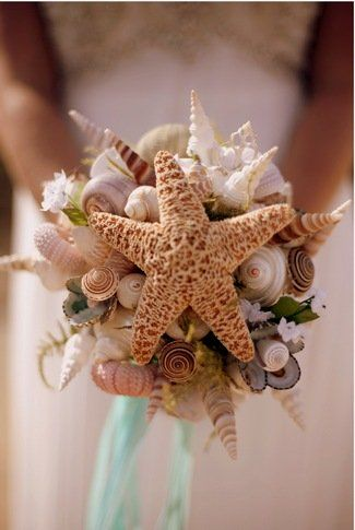 DIY Beach Wedding Inspiration Ideas I got married on a beach in Mexico on valentines day at sunset. My bouquet has silk tropical looking flowers, every security person tried to stop me in the airport because they looked real.:
