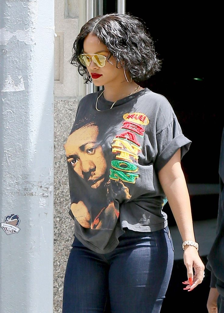 May 24: Rihanna out in NYC.  This is why I luv Rihanna. Check the T-SHIRT That's my gurl.