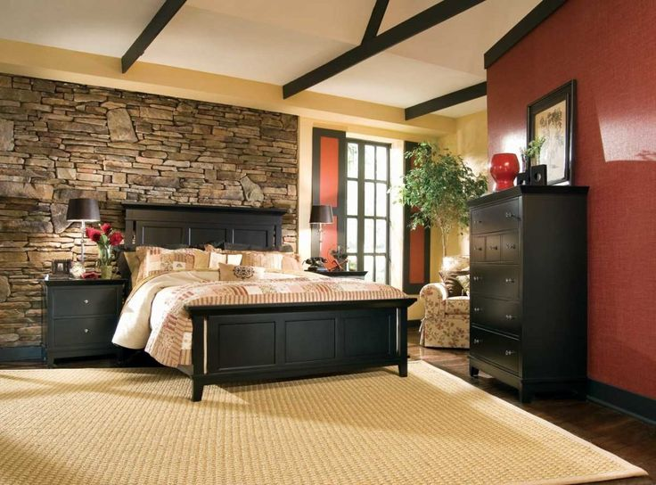 Red And Stone Wall Craftsman Style House With Wooden Bed Frame With Black Color Can Be Applied On The Cream Rug On The Black Floor Inside Bedroom Design Ideas