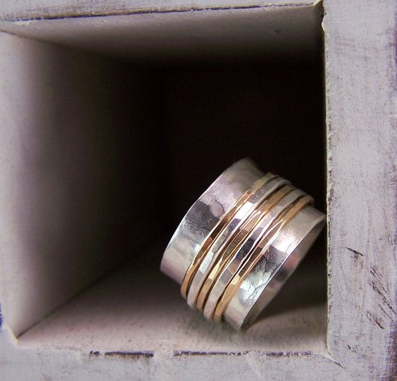 These beautiful hammered bands spin freely around the main band which has also been given a hammered finish. MEMBER - Moodi Chic