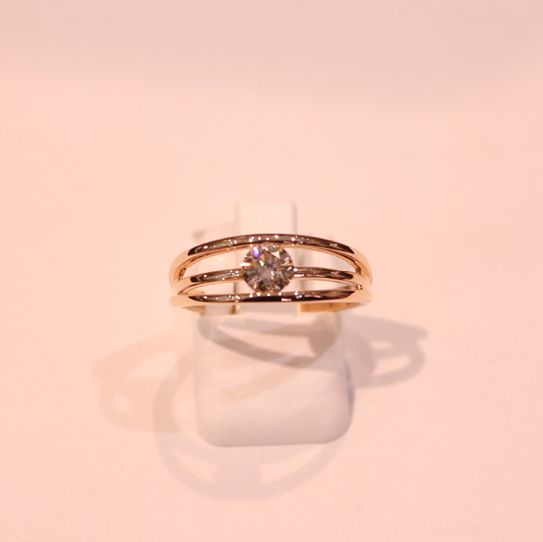 An 18k Rose Gold Split-shank ring set with a 0.51cts light brown SI1.