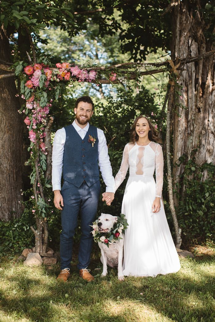 Floral-wreathed pup from this precious backyard elopement in the countryside| Image by  Justin Kunimoto