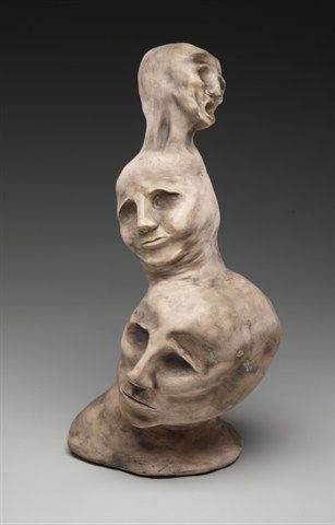"""Nakita Naik, """"Multiple Personality Disorder"""" Ceramics """"The focus of my work has been greatly influenced by mental disorder issues. This piece in particular showcased my artistic interpretation of multiple personality disorder. By producing three heads out of clay and placing them on top of each other, I created an interesting form that portrayed the inner conflict of a victim suffering from this illness."""""""