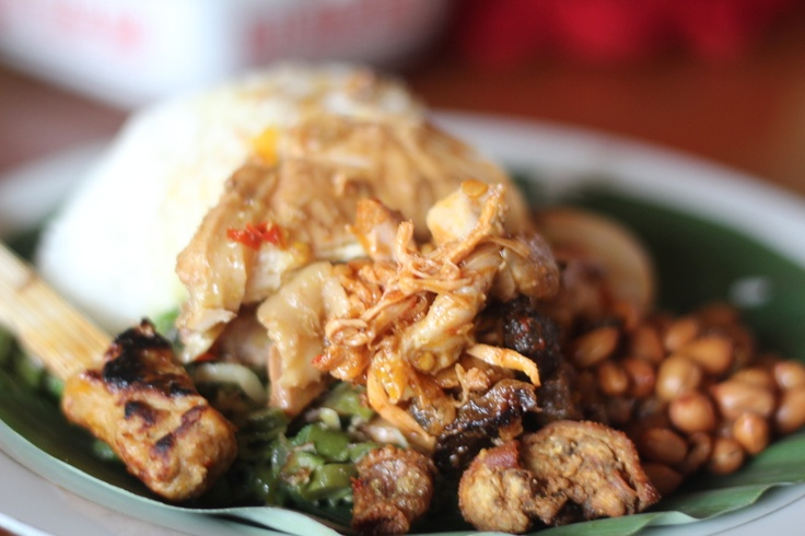 a traditional Balinese food located in Ubud. people named this food as nasi ayam kedewatan . this meal contain of spicy chicken with traditional chilli sauce, vegetables, nuts, boiled spicy egg, and hot rice