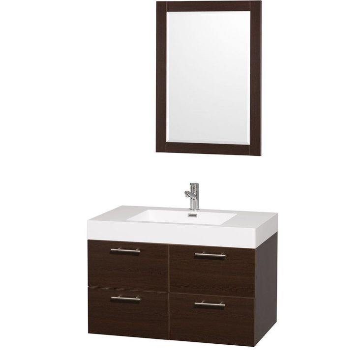 Modern clean lines and a truly elegant design aesthetic define this Amare single vanity set from the Wyndham Collection. An integrated sink breaks up the stark white acrylic top then combines with grey oak-finished wood to complete this bathroom decor.