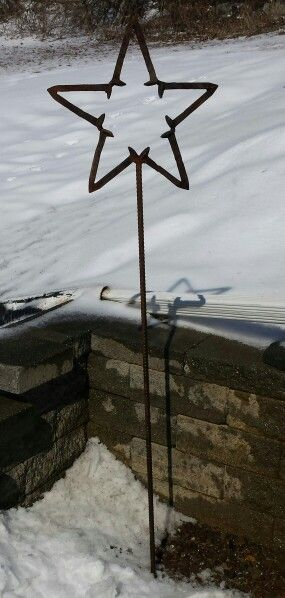 Railroad spike star art by Swartz Ironworkz