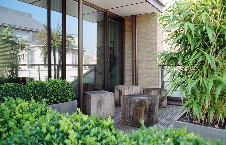 Log stools on roof terrace