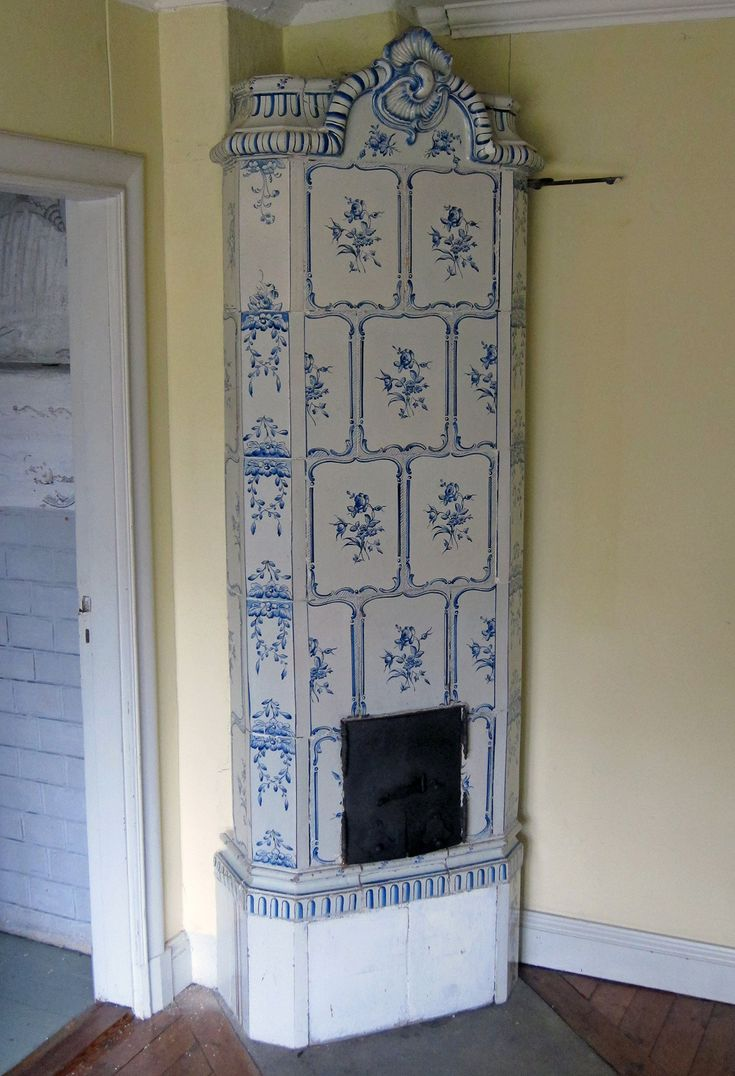 Very old blue and white tiled stove, made in ca. 1750. Height 233 cm, Plinth 34 x 73 cm.