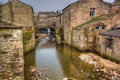 THE RIVER URE  Hawes, England.  One of the prettiest towns I stayed in during my UK visit was Hawes in the Yorkshire Dales.  The Bulls Head Hotel is in a grade-II listed building and provided a great place to sleep for the night (non paid or expected advertisement).  The River Ure passes between houses and shops with a small waterfall making for a great photographic opportunity.