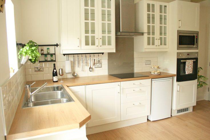 Cream Ikea kitchen, laminate oak worktop, cream metro brick tiles