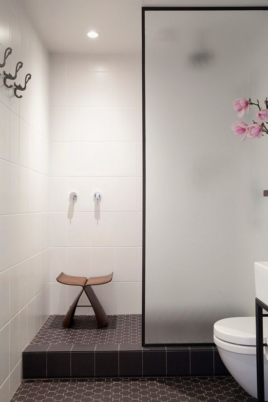 White bathroom wall tile, dark floor tile, simple simple simple - need a little storage spot tho