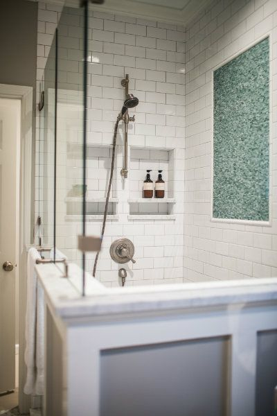 Blue And Gray Bathroom Features A Walk In Shower With Exterior Finished In Wainscoting Filled