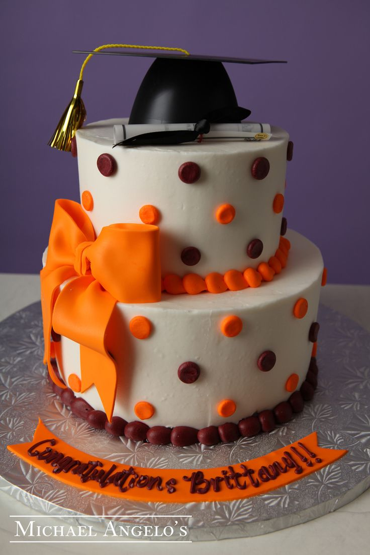 Orange Bow #26Graduation  This cake is iced in buttercream and decorated with polka dots all over. The fondant bow sits nicely on the bottom tier and makes a great center of focus. The graduation cap and diploma are a perfect topper to any graduation cake.