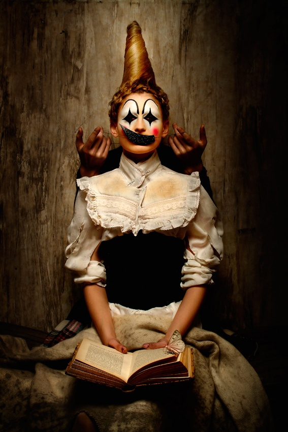 The Clown Secret, © Eolo Perfido. Image for Autunnonero Festival 2007 (the moth on the book was added only for the Autunnonero version by Alessandro Scibilia)