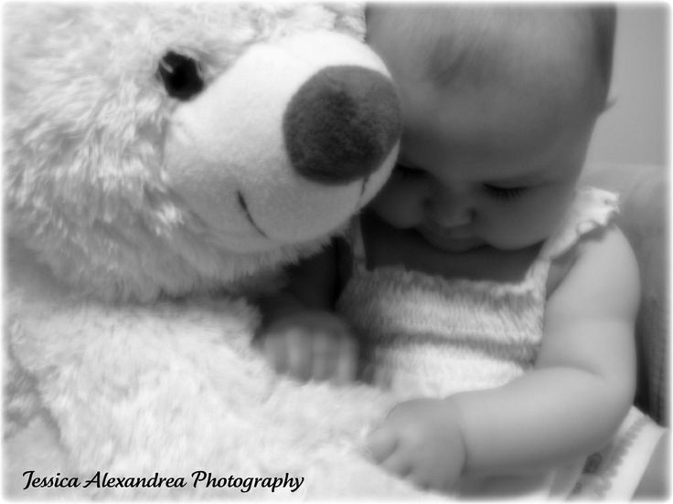 Soft Black and White Baby and her Teddy Bear.