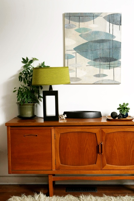 Love this Mid Century Modern vignette with gorgeous credenza and fun lamp and artwork.