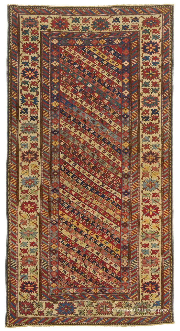 Antique Caucasian Kuba rug with striped Gendje field and salmon