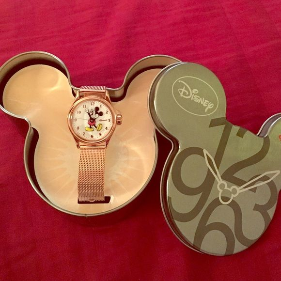 Vintage Mickey Mouse watch BRAND NEW NEVER BEEN WORN VINTAGE MICKEY MOUSE WATCH. It is ROSE gold. This watch is made by ingersoll and is made to look like the classic vintage Mickey watches we all grew up with. This was purchased at Epcot. It still has the sticker on the back and is in PERFECT condition.  Let me know if you have any more questions!! Disney Accessories Watches