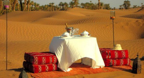 Luxury 3 days tour from Marrakech to Erg Chebbi dunes. Luxury desert camp with luxurious service level, camel trekking, sand boarding, quads, berber music.
