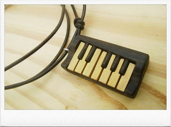 Check out this item in my Etsy shop https://www.etsy.com/listing/259541371/wooden-piano-necklacepianowooden
