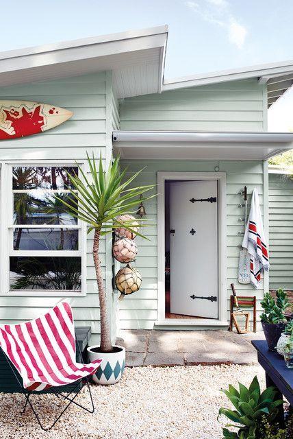 Retro-inspired sage green coastal cottage home exterior.