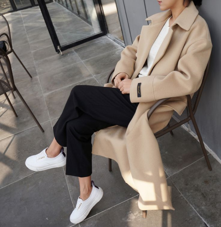 Camel midi coat, black trousers and white top.