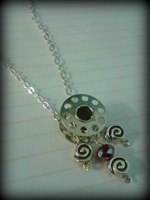 Cute necklace for someone who loves to sew!