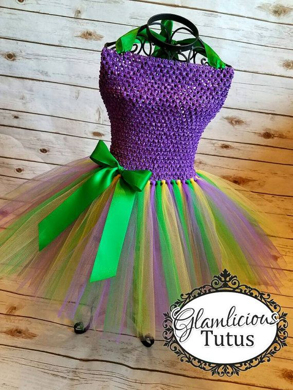 Hello and welcome to my etsy store! This listing is for 1(one) mardi gras inspired tutu dress! The dress is made on a Purple crochet tutu top. The bottom is made of the following colors: Purple, Yellow, and Green. The tutu is 2 layers of tulle ( Please note, the display photo is