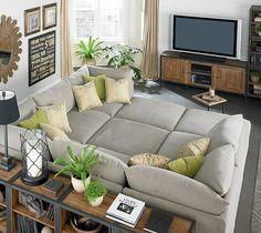 huge gray bassett beckham pit sectional sofa green pillows industrial bookshelves subway sign industrial media