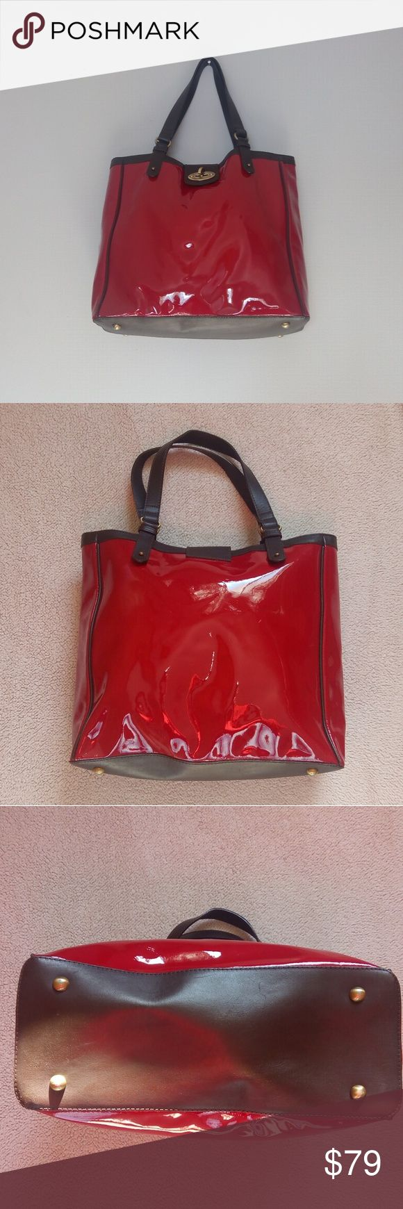 Boden Chelsea Patent Bag This large Boden bag makes a statement. It is a lovely patent red leather with a rich brown leather trim. It has antiqued brass finish hardware and a London cityscape lining. It is in gorgeous condition both inside and out with minor wear to the feet. It features a flap with turnlock closure with one main compartment and three interior pockets(two slip on one side and one zippered on the other side) 100% leather Boden Bags