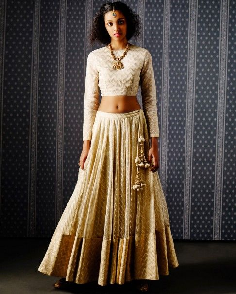 EXCLUSIVE: Ivory full sleeves crop top featuring chevron pattern weave all over. Matching Lehenga with golden zari weave chevron pattern hem.Wash Care: Dry clean only