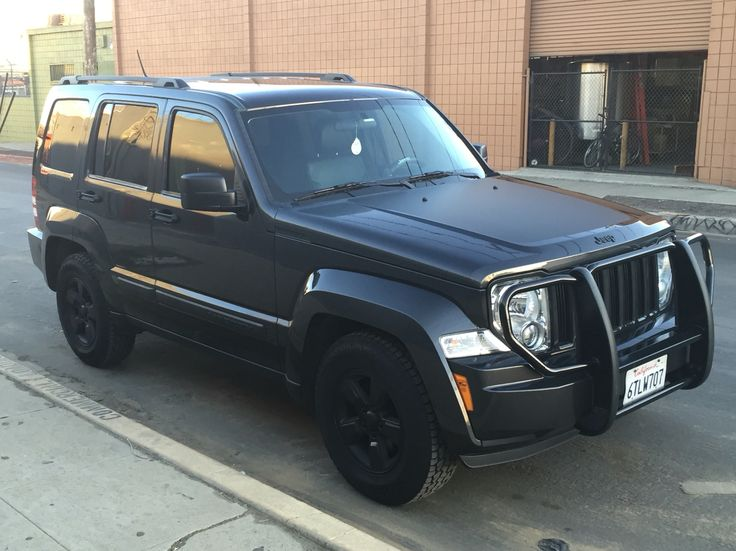Jeep Liberty sport KK 2011 with bumper guards (eBay) tinted windows, matte finish on hood (eBay), Iggie seat covers, and hankook ATM tires