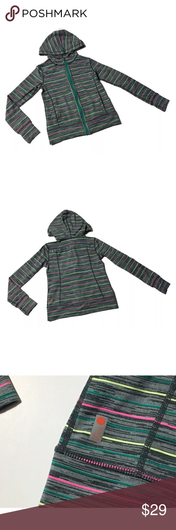 Zella Girl Zip Up Sweatshirt Hoodie Large 10/12 Zella Girl Zip Up Sweatshirt Hoodie Striped Multi Color Gray size Large 10/12, Long Sleeve, Multi color stripes and gray, thumb holes, hooded, two pockets on front, blue zip up in front.  Length, Shoulder to Bottom: 19 inches Armpit to Armpit: 14 1/2 inches Armpit to end of Sleeve: 17 inches  Inventory# AI15 Zella Girl Shirts & Tops Sweatshirts & Hoodies