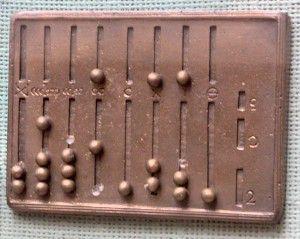 Így számoltunk - MENSA PYTHAGOREANA.  Az abakusz egyik különös fajtája a római Pitagorasz-követők találmánya. A kezdetleges eszközt hatalmas munkával tökéletesítették.