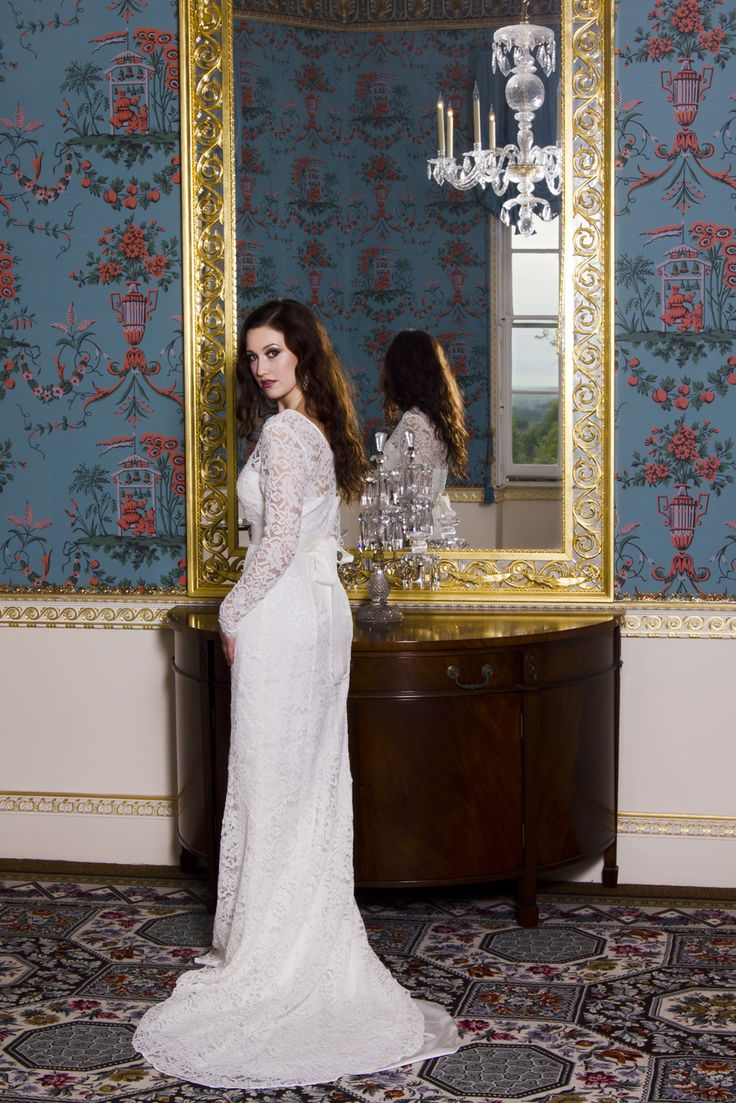 All over lace wedding dress, with long sleeves and sweetheart neckline, there is soft gentle train at back.