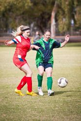 KGM-0002560 © WestPix Soccer, Twin City Saints vs Hannans Celtic, Twin City's Emma Youngberry and Hannans' Ruth Stump.  (Picture: Louise White) 26th July 2015