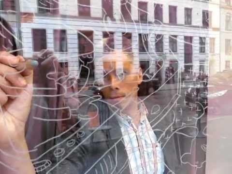 Video clip: Comoll decorating gallery window. Jægersborggade, København.