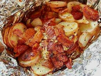 Bacon & Onion Foil Packet Potatoes  2 to 3 sheets of heavy-duty foil 1 packet onion soup powder 10-12 baby red potatoes, thinly sliced 12 slices of cooked and crumbled bacon 1 small onion thinly sliced and diced 1 cup cheese (optional) Salt and pepper to taste 3 tablespoons butter Sour cream for serving (optional)  Spray each sheet of foil with cooking spray. Top each piece with equal portions of potatoes, bacon, 1 packet onion soup powder and mix. Add salt and pepper to taste. Add 1…