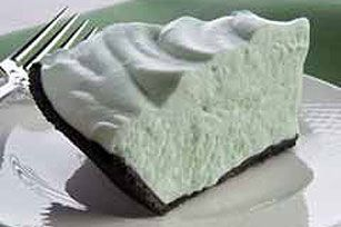 Simplest Grasshopper Pie Ever  1/4 c creme de menthe  7 oz jar marshmallow creme  1 pt whipping cream, whipped  1 oreo pie crust, ready made    Beat first 2 together, stir in whipped cream, pour in shell, chill. Top with dark chocolate curls, or Andes mints.