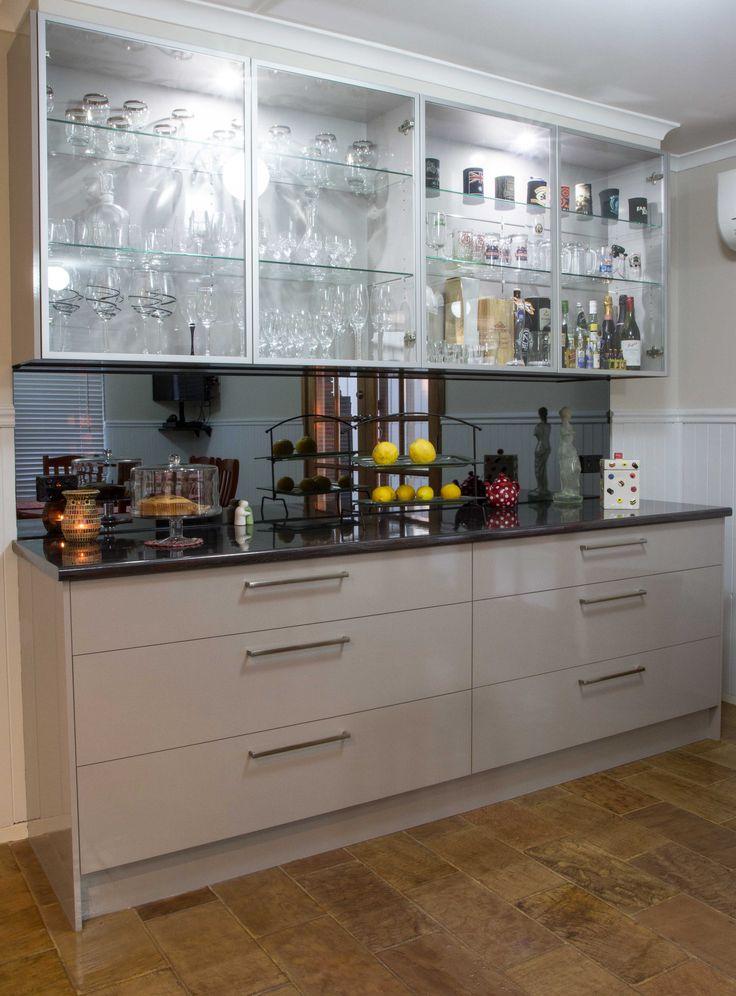 Buffet bar. Glass overhead cabinet doors. Smoked mirror splashback. www.thekitchendesigncentre.com.au