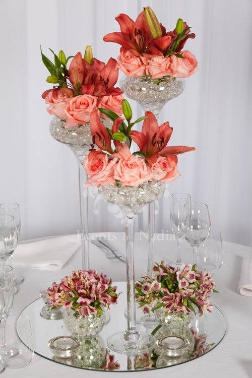 Table Centrepiece Consisting Of Skinny 3 Size Vases With Fresh Floral Posies On Round Mirror Base