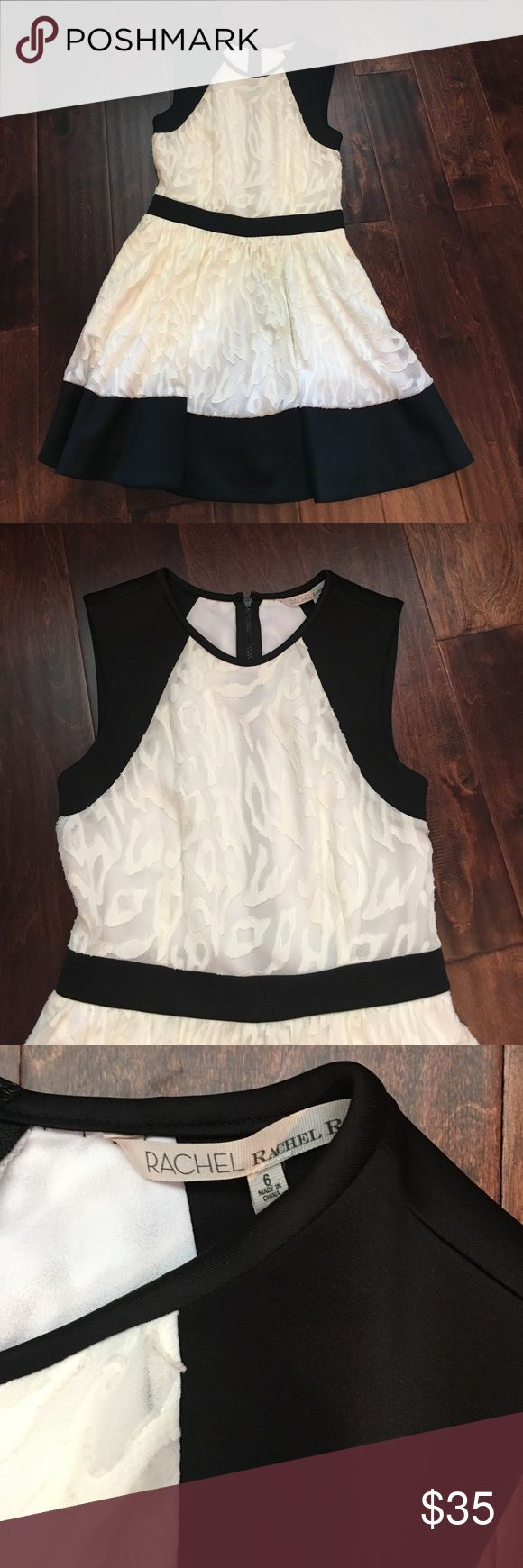 RACHEL by Rachel Roy- black and cream mini dress. EUC- Rachel by Rachel Roy dress. Worn once- no signs of wear. This is a really cute party dress. It could also be worn with some flat sandals for a more casual look. RACHEL Rachel Roy Dresses
