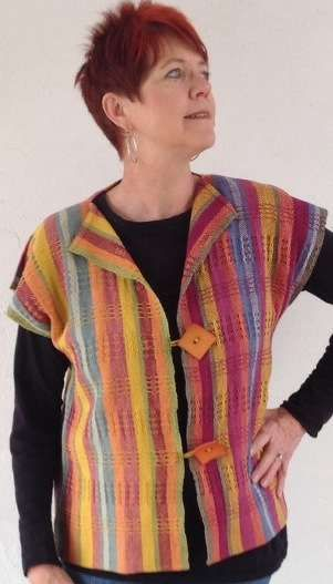 Rigid Heddle Friendship Vest. You'll delight in these brilliant but earthy natural colors in shades of cochineal, indigo, osage orange, madder and overdye of osage orange with indigo. The natural, undyed 8/2 stripes makes the colors pop! Easily woven on any 2+ shaft loom.