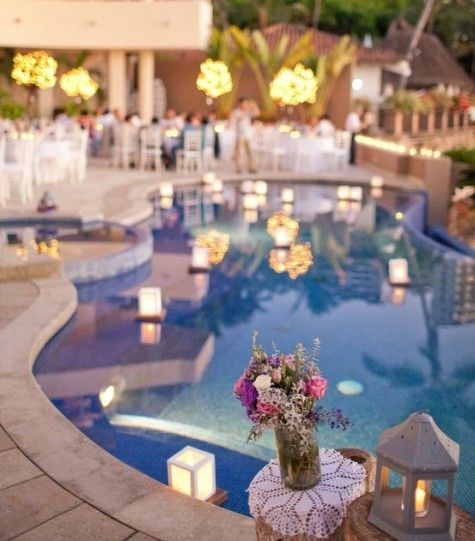 Floating lights.  Loooove!!!  I always dreamed of a reception outside by a pool that has floating candles/lights. This is stunning!