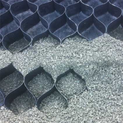 """Lighthoof's flexible, High Density Polyethylene equine mud management panels confine gravel footing in a series of 3"""" deep interconnecting cells. I wan this around the water tank."""