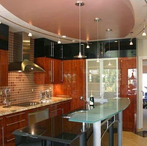 Dise o de peque a cocina moderna con isla de vidrio for Cocinas pequenas con islas modernas