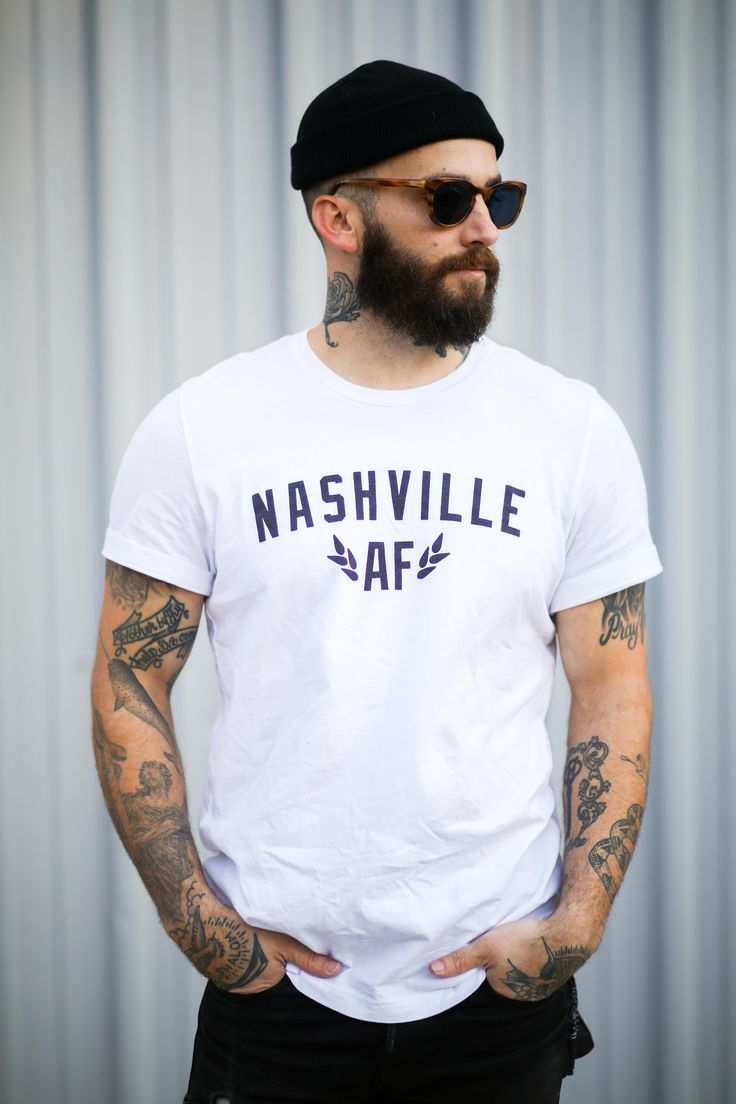 Nashville AF Tee in Black or White. Details Include: -Slim collar -Taped finish along shoulder -Soft feel | Printed in Nashville, TN | Care Instructions: Machine wash cold with like colors, tumble dry