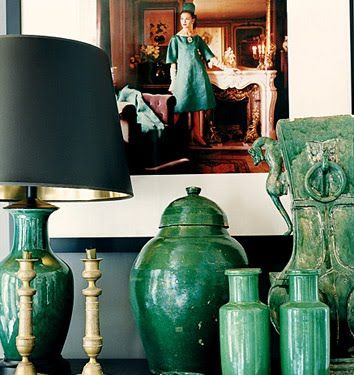 black lampshade, rich teal blue-greens, touches of gold and brass, vintage photos