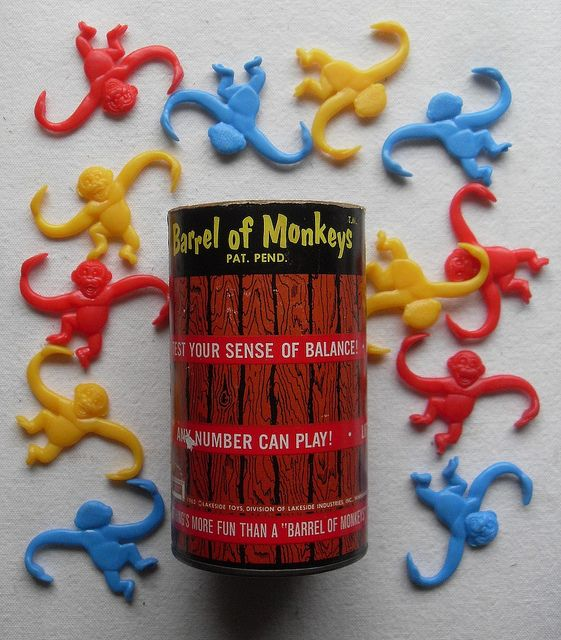 Barrel of Monkeys is a toy game first created by Lakeside Toys in 1965. Dump monkeys onto table. Pick up one monkey by an arm. Hook other arm through a second monkey's arm. Continue making a chain. Your turn is over when a monkey is dropped.