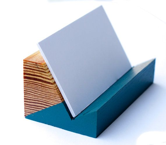 Reclaimed pine wood business card holder. Simple two-toned design and finished with a coat of all-natural wax. Pictured color is valspar satin perfect storm #492449 (blue), march ice #492454 (white), and Folk Art Gold. We also now have a Mint green color in stock (Valspar 772888). An additional option can include a pen holder. These are completely customizable - Weve done a number of different colorways and combinations. Please contact us if youd like specific color or design. Feel free to…